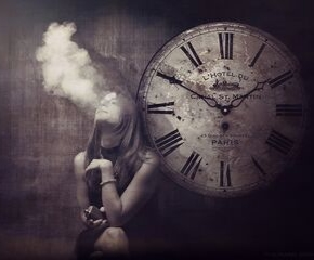 Woman vaping in front of clock